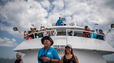 Whale watchers aboard the Atlantic Pearl during a