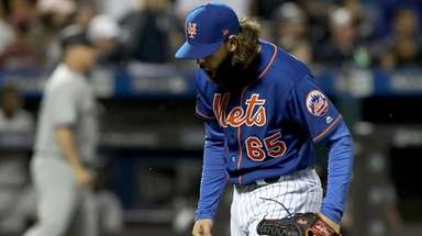 Robert Gsellman of the Mets reacts after the