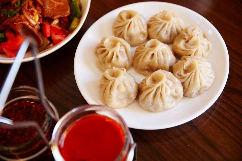 Try the momos (pictured, steamed Tibetan dumplings filled