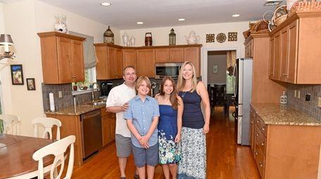 David Susswein, Aileen Kent with their kids, Gavin,