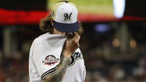 Josh Hader of the Brewers reacts as he