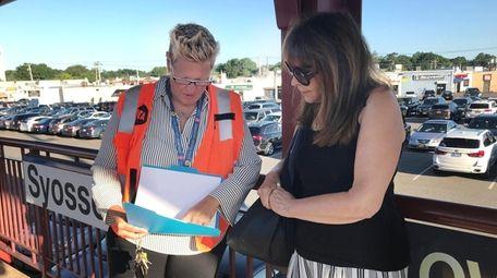 LIRR branch line manager Jennifer Uihlein, left, talks