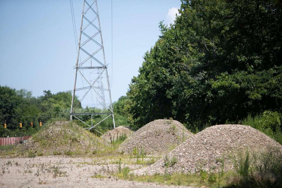 Illegally dumped dirt mounds adjacent to Brentwood State