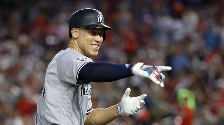 Aaron Judge of the Yankees celebrates after hitting