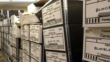 Boxes of documents are piled up June 21