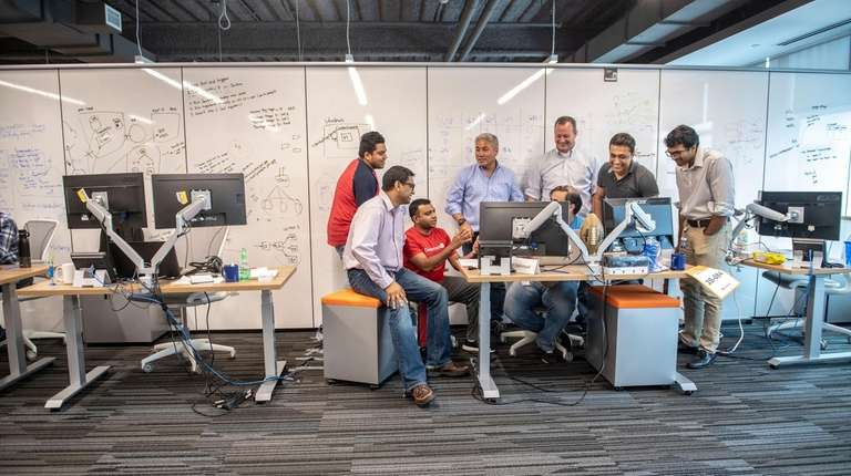 "Employees meet in a ""team cave"" at Dealertrack"