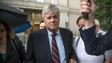 Dean Skelos, center, leaves federal court in Manhattan