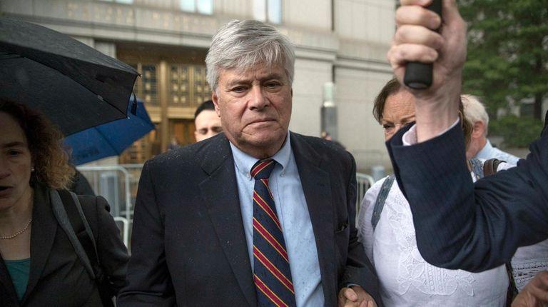 Dean Skelos, center, leaves federal court in Manhattan