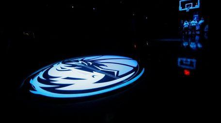 The Dallas Mavericks logo is shown during a