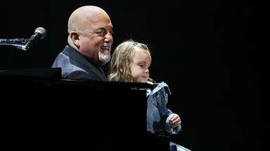 Billy Joel, with his daughter Della, at his