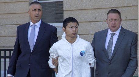Matthew Martinez leaves Nassau County police headquarters on