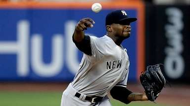 Yankees pitcher Domingo German throws against the Mets
