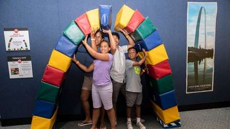 The Escobar family of Patchogue builds an arch