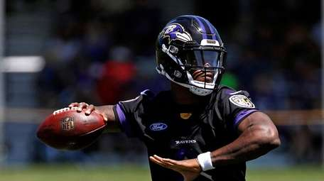 Ravens quarterback Lamar Jackson throws a pass during