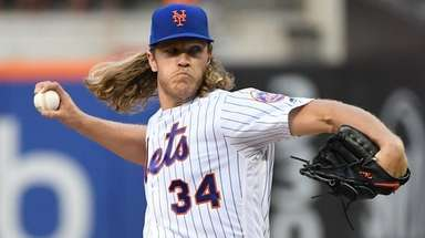 Mets pitcher Noah Syndergaard delivers against the Nationals