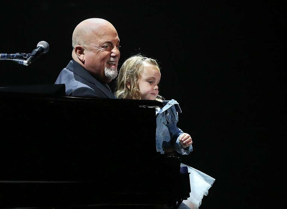 Billy Joel holds his daughter Della on his