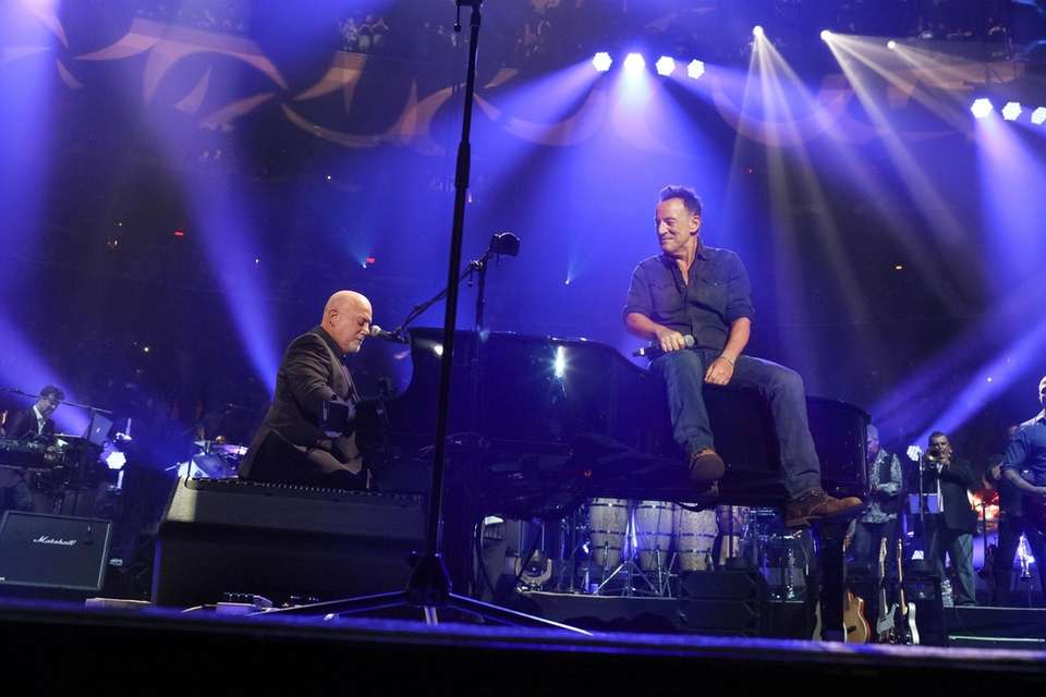 Billy Joel performs with Bruce Springsteen during his