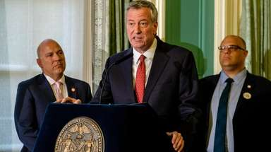 Mayor Bill de Blasio speaks at a bill