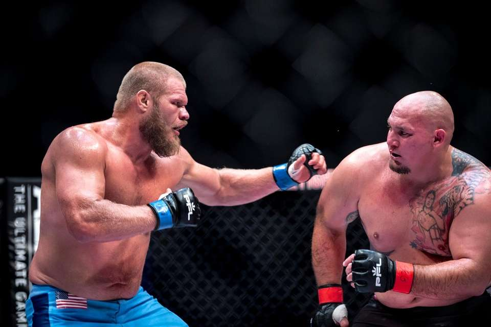 Josh Copeland, left, fights Shawn Jordan during a