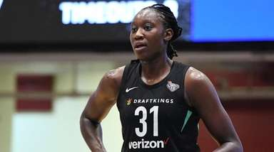 New York Liberty forward Tina Charles looks on