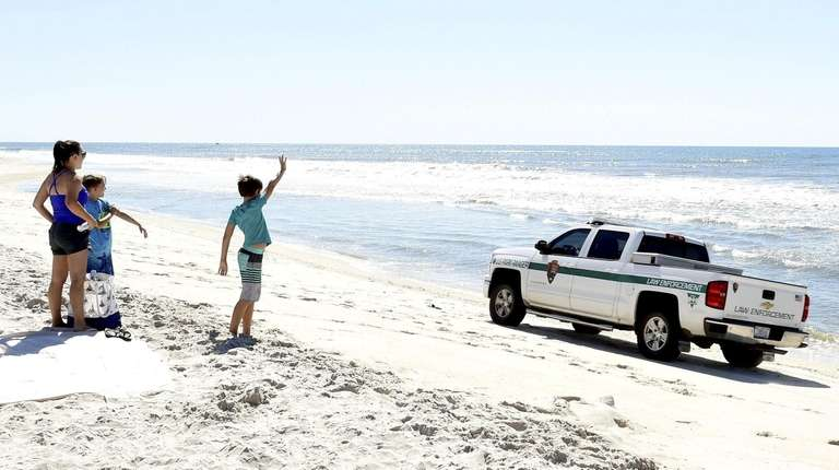 Landon Hershey, 11, waves to a Suffolk County