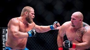 Josh Copeland, left, fights Shawn Johnson during a