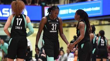 New York Liberty forward Tina Charles and teammates