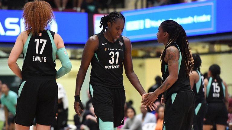 New York Liberty forward Tina Charles and teammates