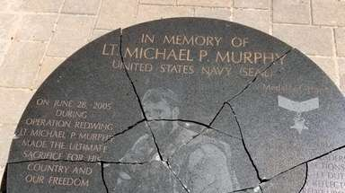 The vandalized memorial in Lake Ronkonkoma that commemorates
