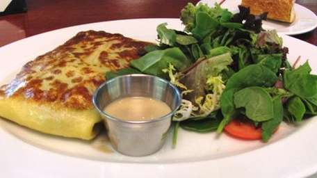 Shrimp-asparagus-leek crepe with salad at Sage Bistro Moderne