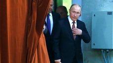 Russian President Vladimir Putin arrives at a meeting
