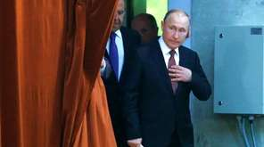Russian President Vladimir Putin arrives at a meeting