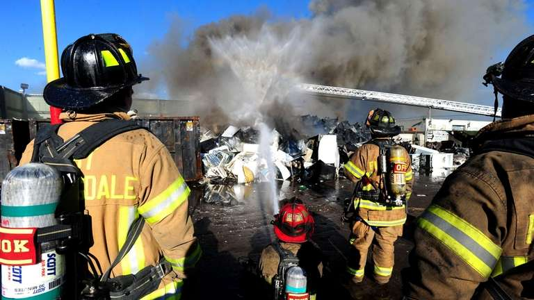 Firefighters battle a blaze that broke out at