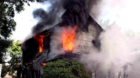 A fire rips through a Roosevelt home Tuesday.