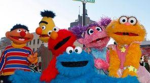 From left, Ernie, Bert, Elmo, Cookie Monster, Abby