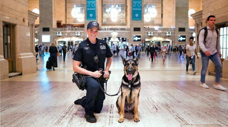 MTA Police Officer Alison Schmitt with her partner,
