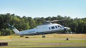 A helicopter lands at East Hampton airport.