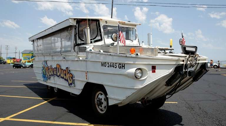 A duck boat sits idle in the parking