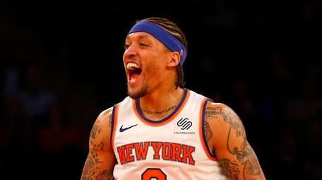 Michael Beasley and Courtney Lee of the Knicks