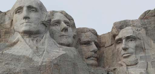 The faces of the presidents that make up