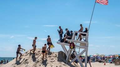 Lifeguards keep watch at Jones Beach on Friday.