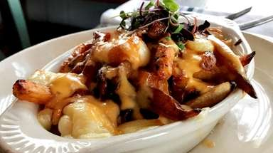 Poutine, with duck-fat fries, red-eye duck gravy and