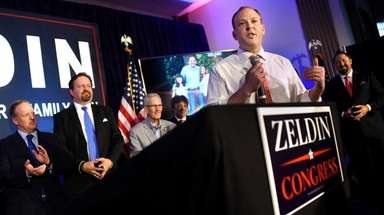 Republican supporters of Lee Zeldin, center, kicked off