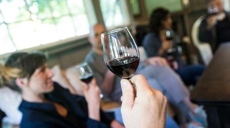 Guests taste wine at a tasting room in