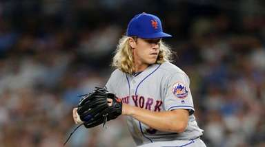 Noah Syndergaard of the Mets pitches against the