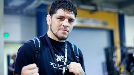 Nick Diaz flashes the hands that he would