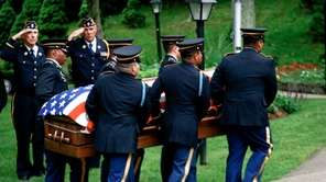 Army Lt. Joseph Theinert's coffin is carried at