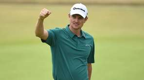 England's Justin Rose reacts after holing his birdie