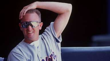 Mets pitcher Bret Saberhagen in the dugout at