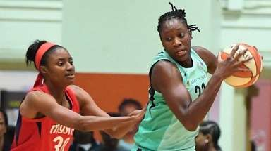 New York Liberty forward Tina Charles is defended